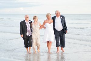 wedding party walks in the water at destination wedding on sanibel island