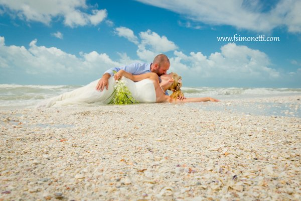 romantic photo of bride and groom on the beach
