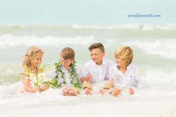 vow renewal with children on beach
