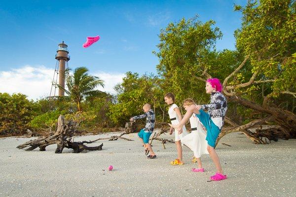 children kick off shoes at Sanibel Island wedding