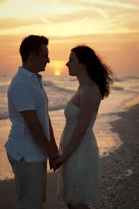 couple pose at sunset on Sanibel Island