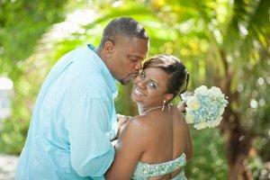 married couple kiss on sanibel beach