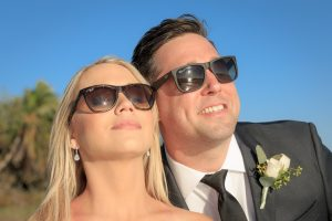 wedding couple with sunglasses on Sanibel beach