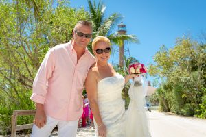wedding couple pose with Sanibel Lighthouse