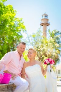 bride and groom pose at the Sanibel Lighthouse