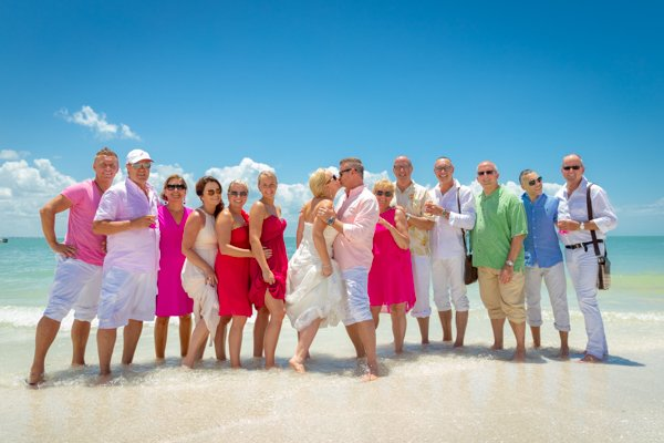 wedding guests pose on Florida beach