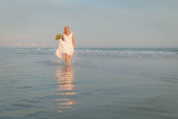 bride walks in the surf at Sanibel Island beach