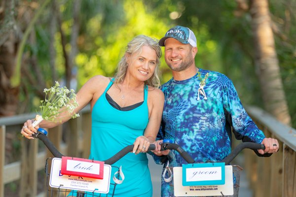 couple arrive to Sanibel Island on bicycles for their intimate wedding