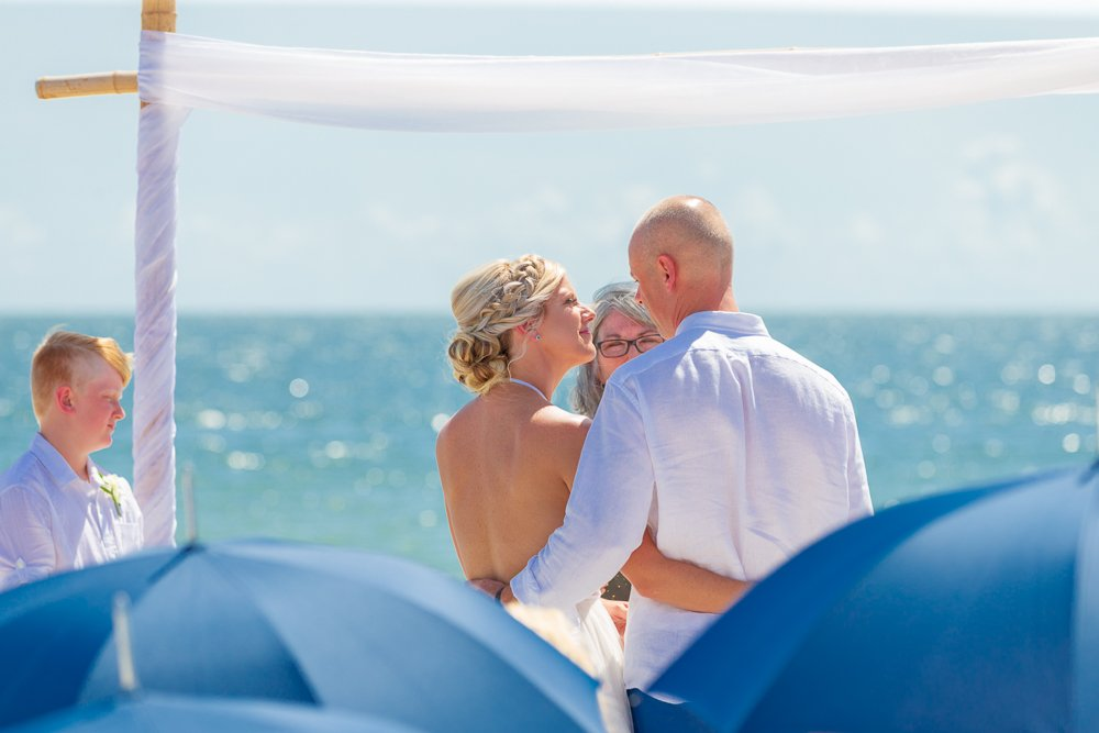 wedding couple enjoy beautiful beach ceremony at Tween Waters Inn
