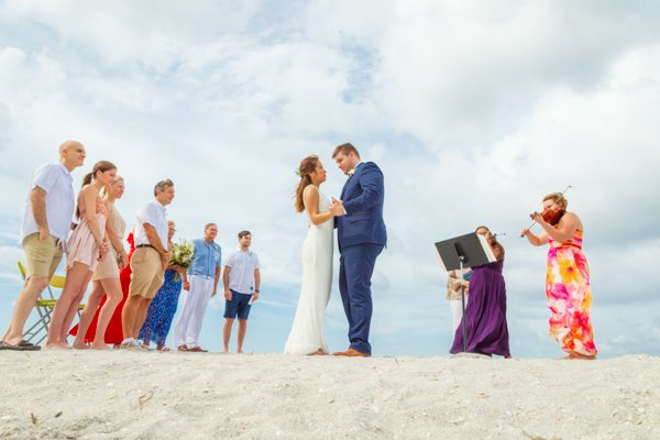 bride and groom have their first dance on a secluded Sanibel Island beach