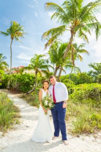 bride and groom with beautiful palm trees on beach