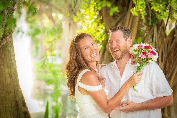 bride and groom laugh at their intimate wedding on Sanibel Island