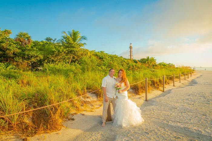 wedding couple at sunrise with lighthouse in background