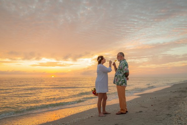 couple toast after their beach ceremony on Sanibel Island
