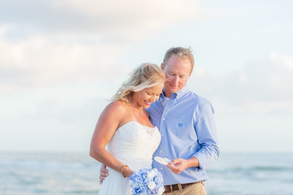 wedding couple find sea shells after wedding ceremony