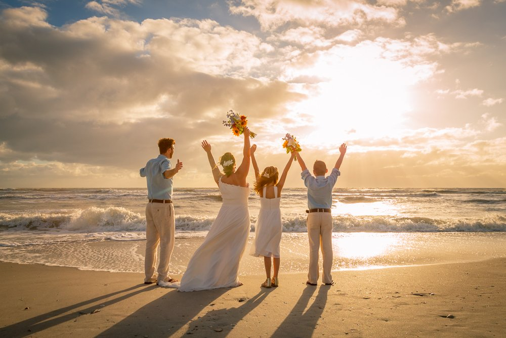 wedding couple with children on Sanibel beach