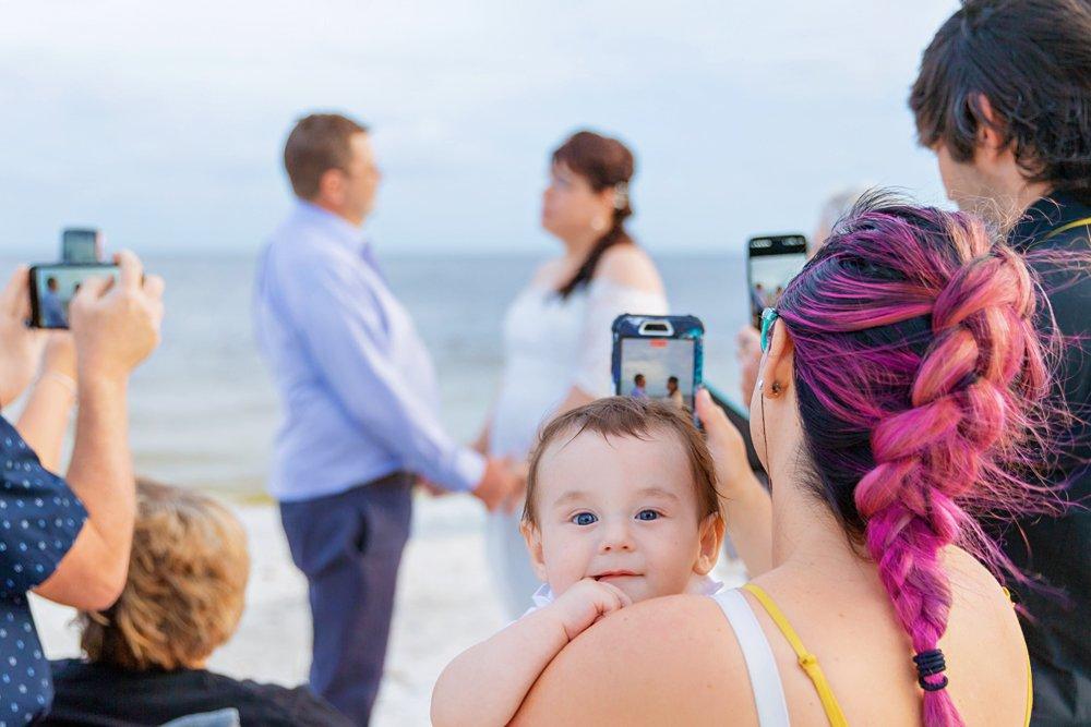 Family at beach wedding